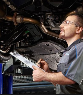 Ford-Certified-Technician-Inspecting-Truck-in-Louisville-KY